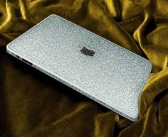 An Apple iPad in 18 carat gold and festooned with 300 carats of wonderful sparklers is designed by the well-known diamond company Camael Diamonds. The company has not only adorned the gadget with regular white diamonds, but has also bedecked the piece with elegant and rare black diamonds on the home button and the Apple logo on the back.