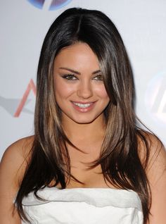 Mila Kunis dark hair with face framing highlights. Want this but not as black at the roots.