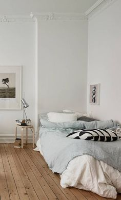 White bedroom with blue duvet