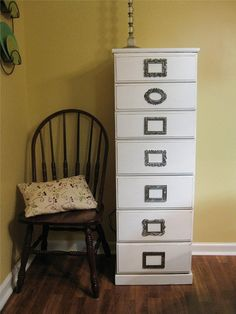 an old dresser with little picture frames on the front. put photos of what's inside or print names,etc