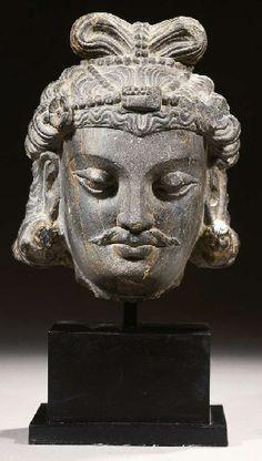 a fine gandhara schist head of a bodhisattva LATE 2ND CENTURY