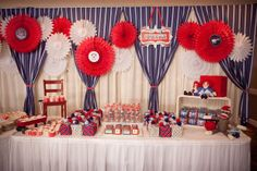 TABLE SETUP: inspiration (this isn't a circus/carnival theme)! I LOVE the curtains and the mix with medallions. I don't know why that chair is there, but it's interesting. the red wagon is an interesting idea too - not sure they're transferable.