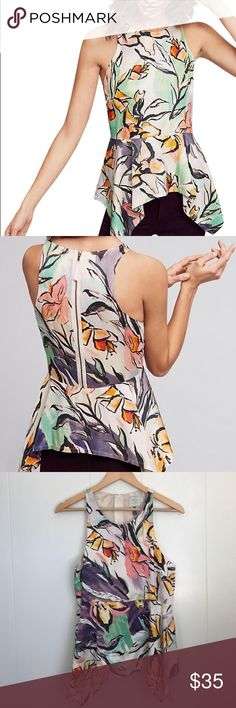 Anthropologie Lucille Peplum Blouse (Size 10) Stunning HD in Paris for Anthropologie Peplum Blouse in size 10. Watercolor style floral print with a visible zipper in back. Like new condition. Length is 25 inches from top to bottom. Anthropologie Tops Tank Tops