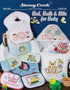 """Bed - Whoo's hungry?"""" """"Shhh..Baby Sleeping"""", """"Food? I dig it!"""", """"Princess in Training."""" Models stitched on pre-finished pillows, quilted baby bibs and hooded bath towels with DMC or Anchor floss."""