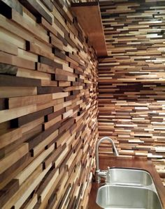 Wood wall behind the bar in my man cave made using woodworking scraps from my DIY shop.
