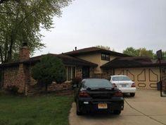 Corner brick split level with attached 2 car garage in Justice, #Illinois
