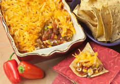 Move over seven layer dip, there's a new crowd favorite: Game Day Hashbrown Chili Dip. Cream cheese, chili beans, corn, southwest-style diced tomatoes and green onions under a crispy hashbrown topping. Serve with tortilla chips for dipping. Tasty and quick - it only cooks in only 20 minutes. Get the recipe here: http://hungryjackpotatoes.comHashbrowns make a crispy topping for layered bean dip. Serve with tortilla chips for dipping.