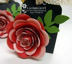 Love the Spiral Die!   from Flowerbug's Inkspot --I wonder if a rose could be made using different sized heart punches?