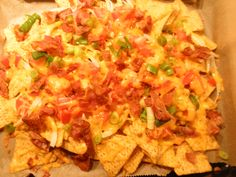 Nachos with bacon, tomatoes, spring onions, olives covered in melted cheddar!or you can substitute/add any topping you want Hawaiian Pizza, Nachos, Olives, Cheddar, Tomatoes, Onion, Food And Drink, Canning, Spring