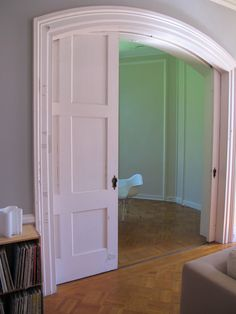 graceful arched doorway pocket doors