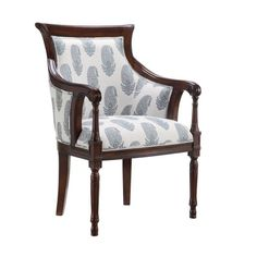 Wrapped in paisley-print upholstery and awash in a rich dark walnut finish, this arm chair offers a traditional touch to any space.