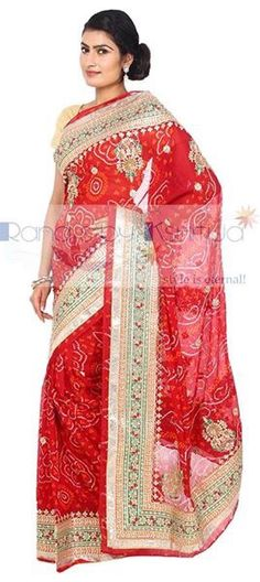 Royal, radiant and very red. Ravishing gota worked Saree.