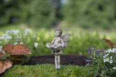 "An adorable miniature fairy for miniature fairy gardens. ""Brook"" Features An adorable miniature fairy for miniature fairy gardens ""Brook"""