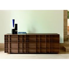 Kilt sideboard from Porada. Solid walnut and handles grooved in the decoration itself.  Kibo Living is the exclusive agent for Porada in the Nordic countries and we have a retail store located in Denmark as well. We look forward to being at your service. www.kiboliving.com