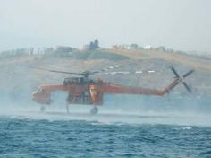 Sikorsky Skycrane dipping straight out of Lake Chelan in support of initial attack.