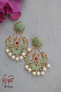 Sabyasachi jewellery Green large Meenakari Chandbali Dangler Earrings Sabyasachi inspired Indian Jewelry for women Pastel Green large Meenakari Chandbali Dangler Earrings Sabyasachi inspired Indian Jewelry for women Indian Jewelry Earrings, Indian Jewelry Sets, Fancy Jewellery, Jewelry Design Earrings, Gold Earrings Designs, Indian Jewellery Design, India Jewelry, Stylish Jewelry, Women Jewelry