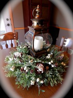 Christmas lantern centerpiece! Even though Christmas just passed by... I really love pinterest's ideas for the holidays! :)