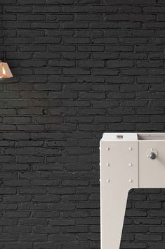 Black is a fantastic contrast for light, bright, muted and glossy colours alike, it's elegant and sophisticated. This black brick wall adds a struc. Black Brick Wall, Black Wallpaper, Designer Wallpaper, Urban Fashion, Pretty Little, Decoration, New Homes, Interior Design, Loft