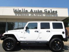 White Jeep Wrangler Unlimited with Rockstar rims