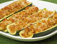 These hollowed out zucchini boats are stuffed with a simple mixture of sautéed sweet onion, zucchini and mozzarella cheese. NOTE: I added slices of salted tomato to the top then baked / broiled. Vegetarian Zucchini Boats, Zucchini Boat Recipes, Vegetable Recipes, Vegetarian Recipes, Cooking Recipes, Healthy Recipes, Healthy Food, Stuffed Zucchini Recipes, Healthy Eating