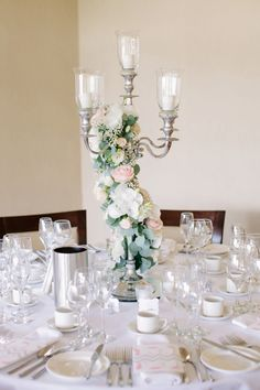 Wonder if candleabra as centrepieces are a more cost effective option? Less flowers?