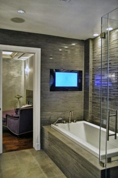 TV over the bathtub, nice way to relax after a long day: Contemporary bathroom by Leib Designs