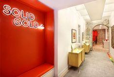 New York Duplex Apartment by Ghislaine Vinas Interior Design custom bench cabinet neon 1