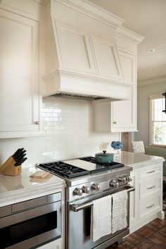 Kitchen Inspiration A custom hood can blend in AND make a statement. The custom cabinetry in this ki Kitchen Hood Design, Kitchen Vent Hood, Kitchen Stove, Kitchen Cabinetry, Kitchen Redo, Home Decor Kitchen, Country Kitchen, Kitchen Interior, New Kitchen