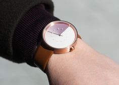 A Unique Watch That Tells Time With A Gorgeous Rotating Color Gradient Display - DesignTAXI.com