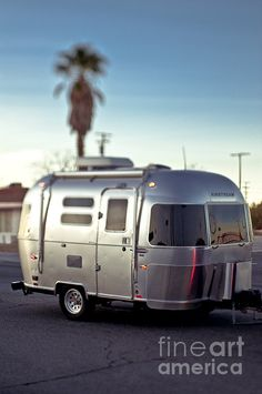 Buy a 16 foot Air Stream sport and travel the country with my love!