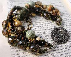 Woodland - Ceramic, Czech Glass, Enameled Metal, Brass and Wood Multiple Strand Bracelet. $40.00, via Etsy.