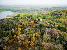 Nestled in a forest overlooking a spectacular dam in south-eastern Zimbabwe's Malilangwe Wildlife Reserve, the all-inclusive Singita Pamushana Lodge offers secluded luxury amid breathtaking views. Game Reserve, African Safari, African Animals, Fauna, Africa Travel, Oh The Places You'll Go, Aerial View, Hotels And Resorts, Lodges