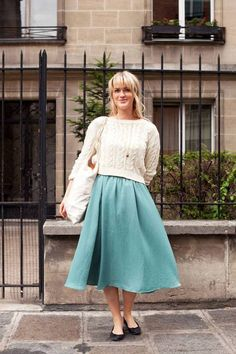 Street Style: Captured in the streets of Paris, Kari epitomizes easy French style in a knubby sweater and voluminous circle skirt.