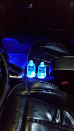 Closeup picture of the blue LED cupholder lighting I just installed in the custom 2007 Hummer H3X I've worked on for over a year. Client keeps two water bottles now in his arm storage, so at night he puts them in to have this so cool effect. www.nomadicmechanic.com