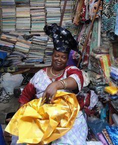 Making hats on the market of Cotonou, Benin