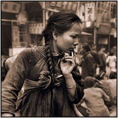 Young Mother Carrying A Child On Her Back In The Market, Hong Kong Island [c1946] Hedda Morrison