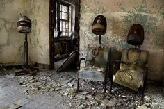 Two old chairs in an abandoned hair salon...wondering what the walls and chairs heard while it was thriving. If only abandoned places could tell their stories.