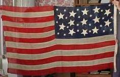 A very unusual Old Glory. It has 34 Stars. Notice the Larger 13 Stars.