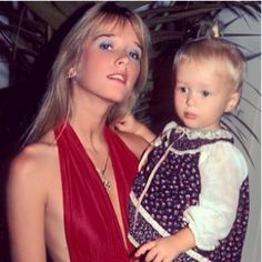 Can you identify the famous baby that #RHOBH star Kim Richards is holding in this photo?