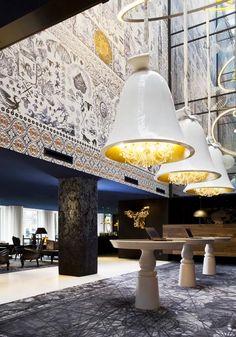 The Andaz Hotel in Amsterdam by Dutch designer Marcel Wanders features chandeliers encased inside huge bells.