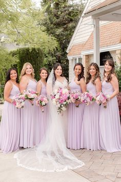 bride poses with bridesmaids in lilac gowns outside home   Spring microwedding inspiration in Staten Island NY photographed by New York wedding photographer Idalia Photography. Planning an intimate microwedding? Find inspiration here! #IdaliaPhotography #NYWedding #StatenIslandWedding #SpringWedding #Microwedding Bridesmaids, Bridesmaid Dresses, Wedding Dresses, Spring Wedding, Wedding Day, Bridesmaid Getting Ready, Bride Poses, Bridal Parties, Wedding Officiant