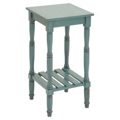 Wood end table in blue with turned legs and a slatted bottom display shelf.  Product: End tableConstruction Materia...