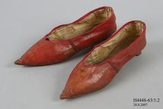 Slip on shoes, pair, womens, leather, maker unknown, England, c1790-1810    Womens pair of straight slip on shoes of turnshoe construction with needlepoint toes and covered wedged louis heels. Shoes consist of red morocco leather uppers, low cut, oblique side seams and silk bound edges. Uppers lined in linen with grip in back and the sock/insole is coarse linen. Red morocco heel white stitched and leather sole features a sueded forepart and fiddle finish at the waist.