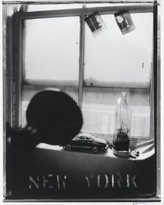 """""""When people look at my pictures I want them to feel the way they do when they want to read a line of a poem twice."""" Photographer Robert Frank turns 92 years old today! [Robert Frank. """"Pablo's Bottle at Bleecker Street, New York City."""" 1973. Gelatin silver print. Promised gift of Michael Jesselson. © Robert Frank; courtesy Pace/MacGill Gallery, New York]"""