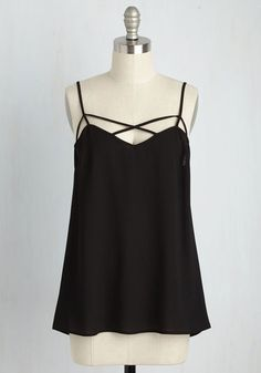 Your task? Take this black tank - a piece of our ModCloth namesake label - from daytime activities to nighttime fun. By implementing your style savvy on the strappy silhouette and breezy crepe fabric of this truly unique top, you'll victoriously craft outfit after ensemble with the inspiration it offers. Easy!