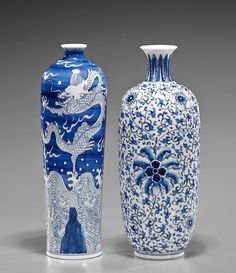 "Two Qianlong-Style Blue & White Porcelain Vases of cylindrical form with small mouth, depicting an auspicious dragon above waves reaching for the flaming pearl; together with a small mouth ovoid form, decorated in scrolling lotus motif; each with four-character mark; H: 10"" (larger)"