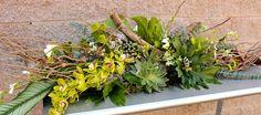 Succulent Spray, Cymbidium Orchids, Tropical Leaves, Freesia, Driftwood, etc; $330