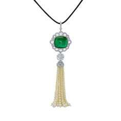 A Colombian emerald sugarloaf of 39 carats set within a pavé-set border framed by rose-cuts within a further pavé border to a 7.29 ct L VS2 round brilliant diamond above a round brilliant and rose cut diamond dome top with graduated pearl strands each accented by a diamond briolette forms a tassel. Mounted in platinum. Total diamond weight 21.55 cts, total pearl weight 106.62 cts.