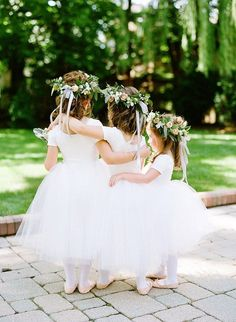 Umm ADORABLE flower girls at this boho chic  garden wedding. Love those flower crowns!
