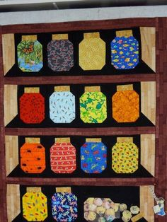 NICE 3-D EFFECT AND USING THE FABRIC PATTERNS TO SIMULATE FRUIT OR VEGGIES IN THE JARS IS KIND OF FUN.